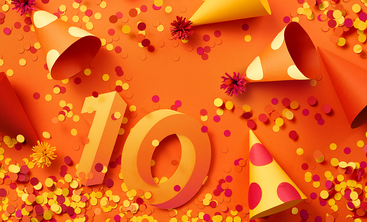 Still life photograph for Zalando's 10th anniversary Campaign. Confetti, party hats, orange