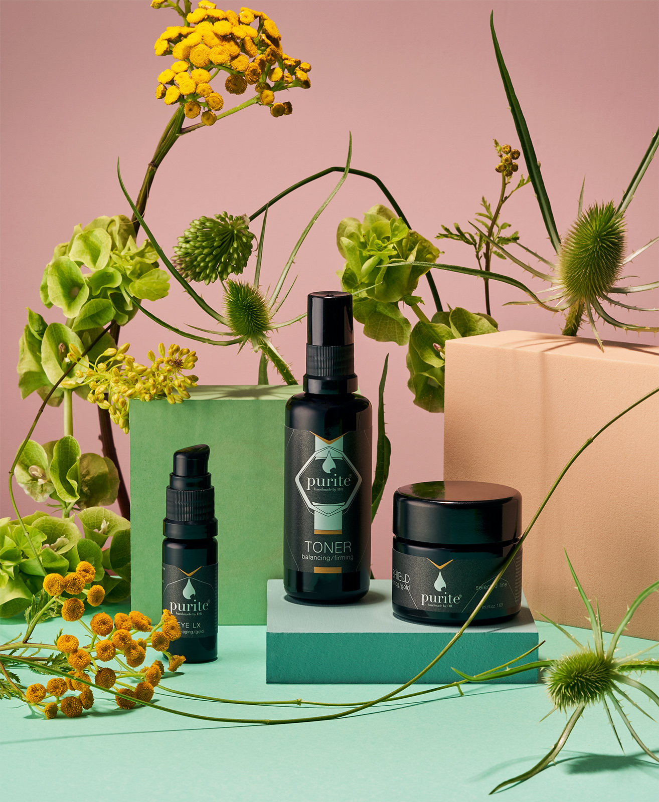 Still life for LABEL Magazine with flowers and purite natural cosmetics
