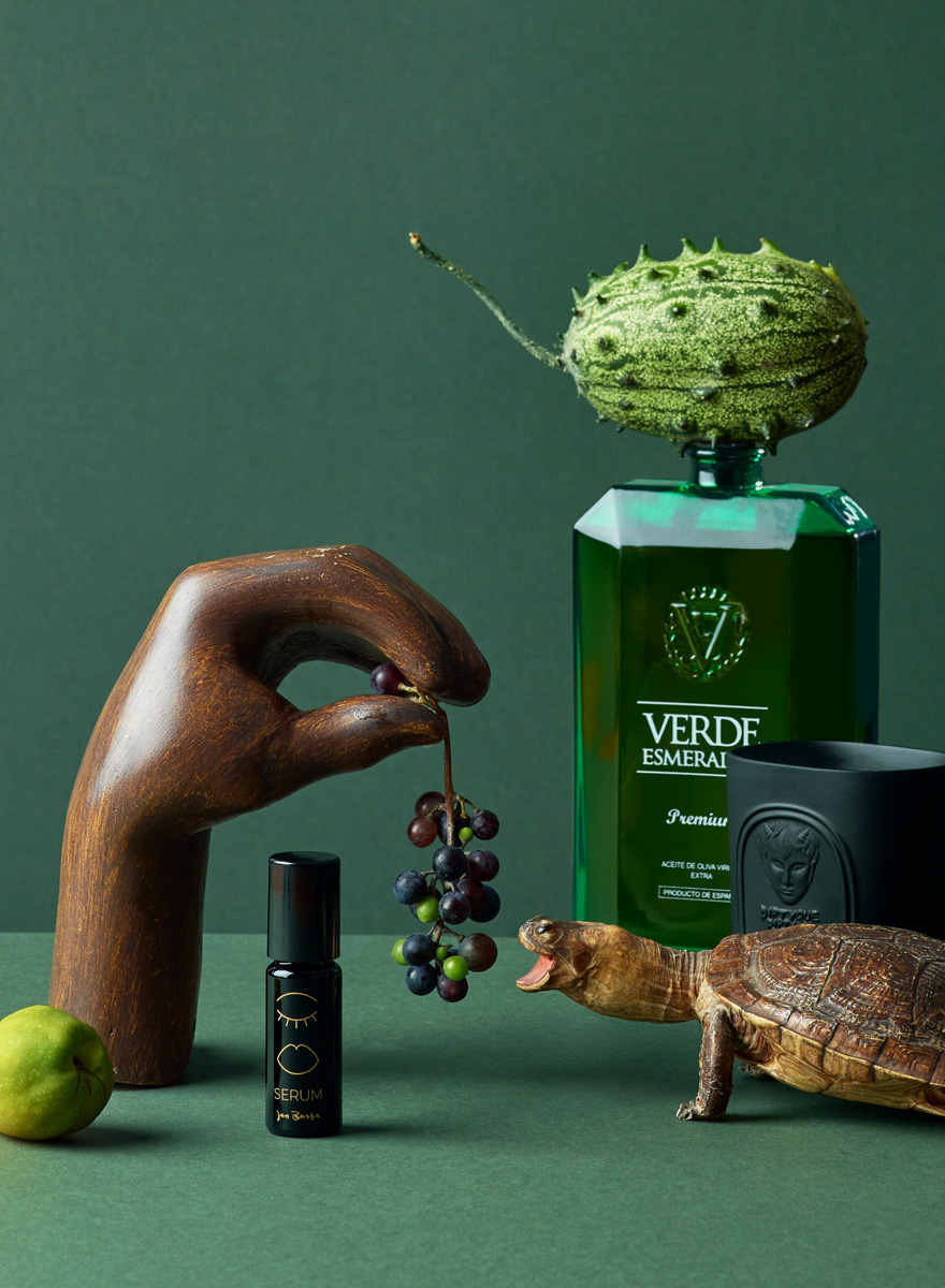 Still life photography with grapes turtle, hand olive oil candle and serum for Usta Magazine