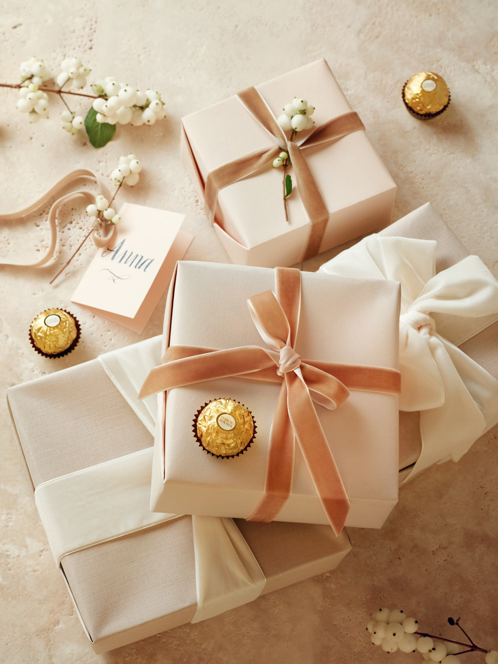 Still life picture with beige gifts and Ferrero Rocher