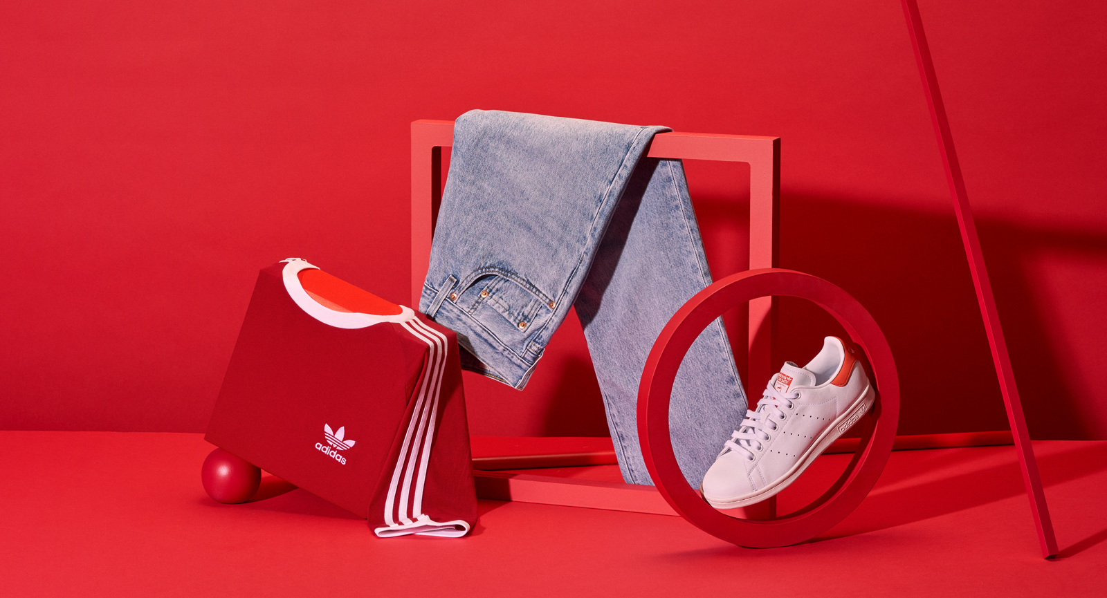 Abstract clothing still life with t-shirt jeans and shoe