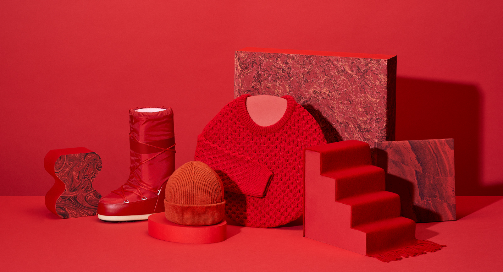 Zalando sale campaign image with winter gaments - sweater, boot, hat and scarf