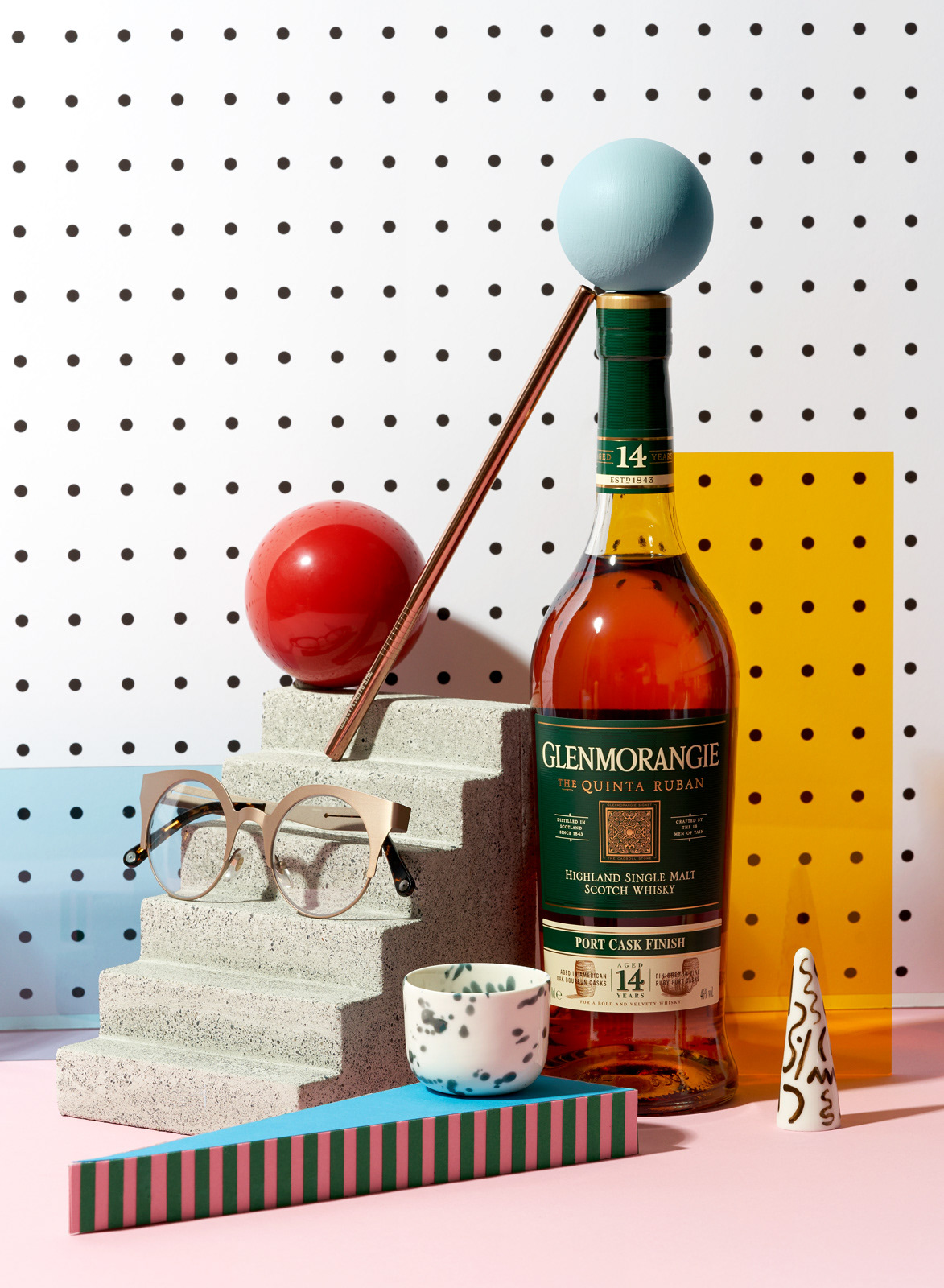 Memphis Design inspired still life gift guide with Whiskey, glasses and handmade ceramics